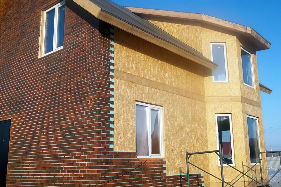 Облицовка фасада частного дома: какой материал лучше, дешевле, чем отделать, советы + фото